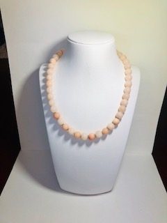 Beads with non-clear glossy coral Farah