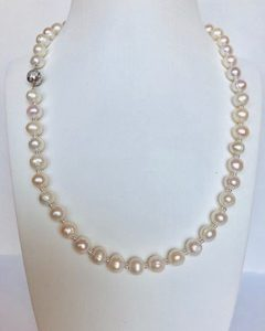 Pearls with gold accents and clasp